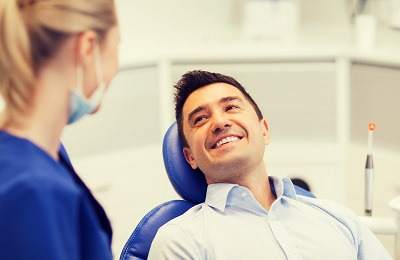 Image of happy male patient in dental office