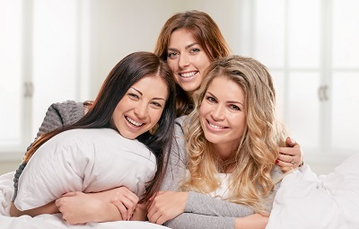 portrait of three female friends